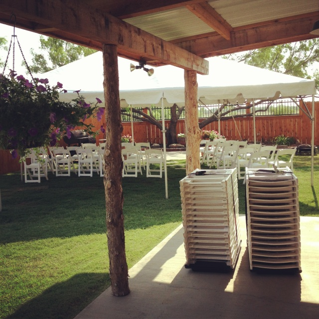 Getting everything wedding ready in my parent's backyard.