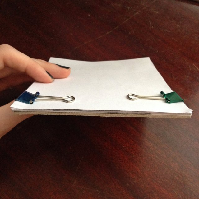 binder clips on paper