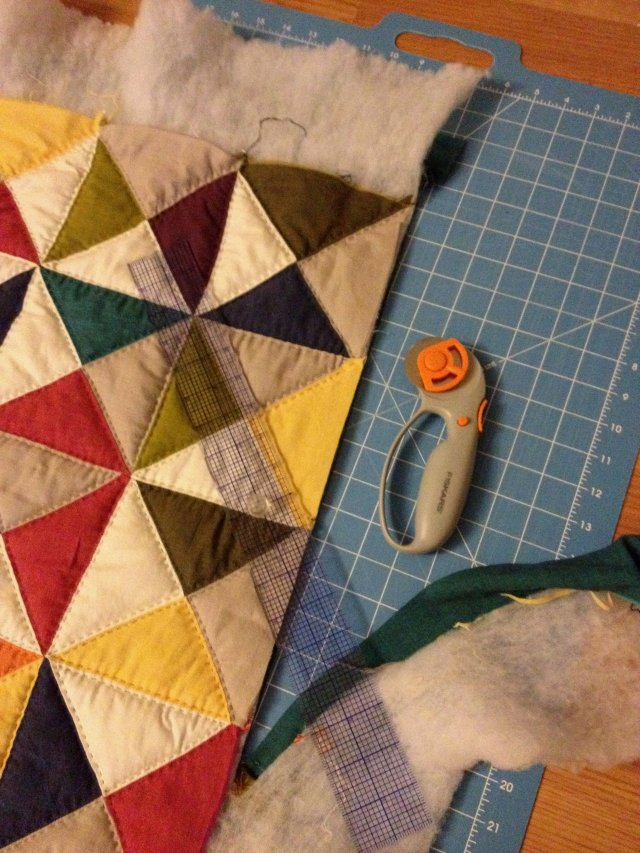 cut the excess off the outside of the quilt